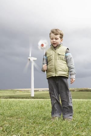 liable: Boy with windmill on a wind farm