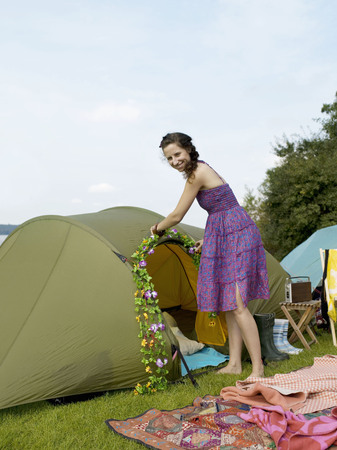 singularity: Woman decorating a tent with flowers