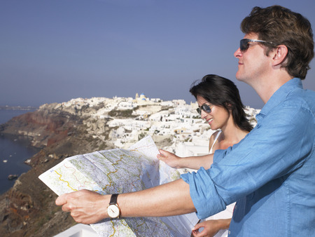 honeymooner: Couple looking at a map