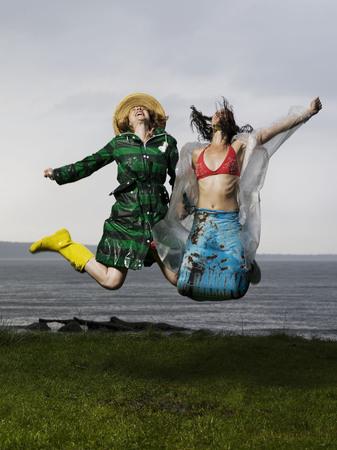 rejuvenated: Two women jumping together LANG_EVOIMAGES