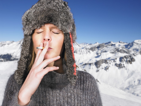 furs: Young woman in hat smoking