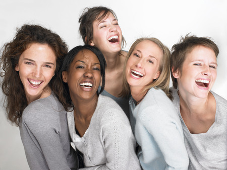 gals: Women smiling and looking at the camera