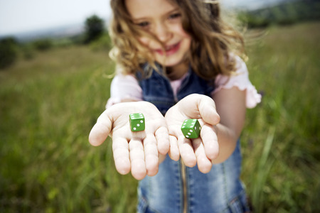 Girl holding dice