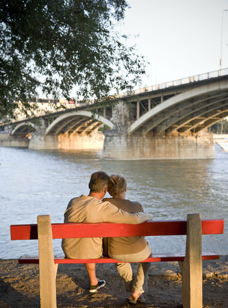 Couple on bench by river