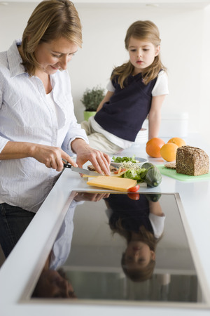 45 50 years: Mother preparing sandwich for daughter