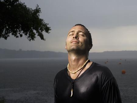 drizzling rain: Man standing in rain, eyes closed