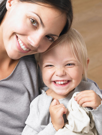 accountable: Mother and daughter smiling