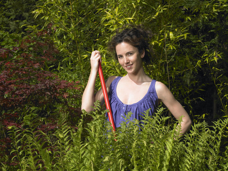 attractiveness: Woman working in the garden