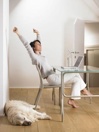 singularity: Woman at her desk, dog sleeping