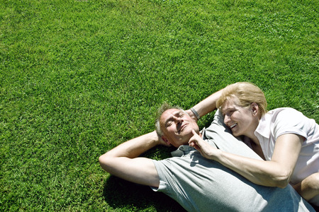 constant: Man and woman lying on grass together