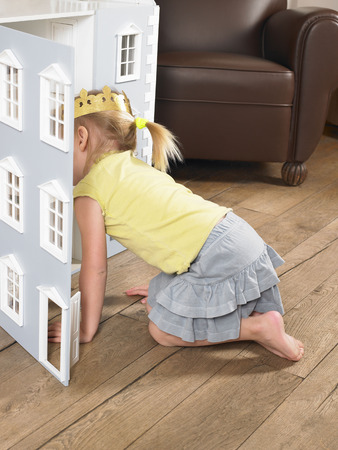 peep: Little girl playing with a doll house
