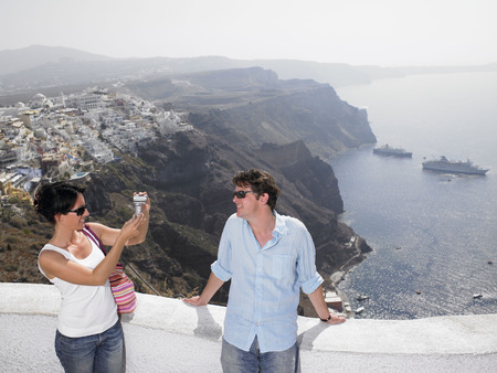 honeymooner: Woman taking pictures of her man