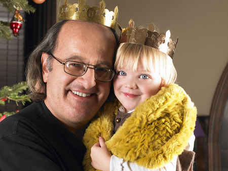 Girl and grandfather with crowns