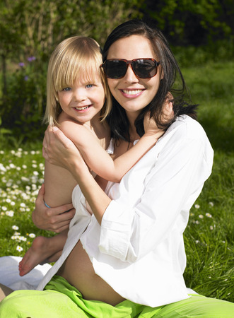 accountable: Mother and daughter smiling, outdoors LANG_EVOIMAGES