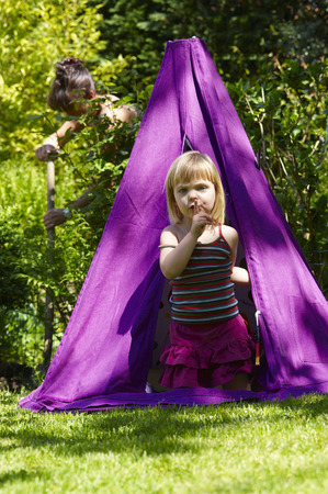 adventuresome: Girl in a teepee, shot from outside