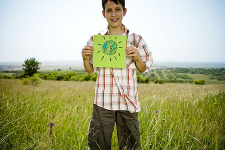 Boy holding picture of earth