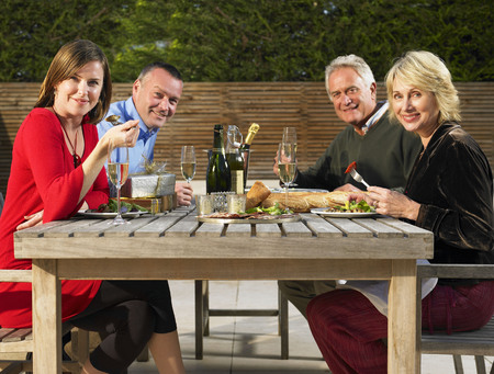 refreshed: Two couples eating outdoors