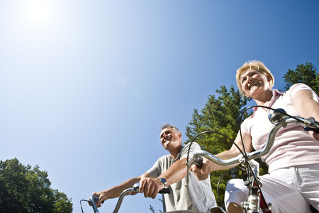 Couple cycling, low view