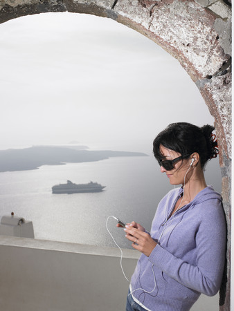 easygoing: Woman listening to music with ear phones