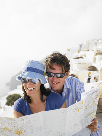 resolving: Couple looking at a map, laughing
