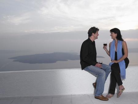 honeymooner: Couple toasting glasses, sea view