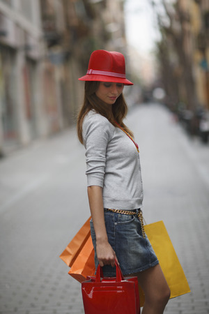chic woman: Young woman walking with shopping bags
