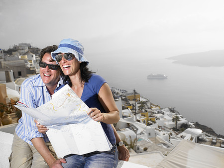 easygoing: Couple looking at a map, laughing