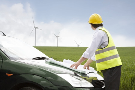 liable: Man looking at wind turbines LANG_EVOIMAGES