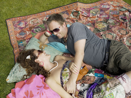 Man and woman lying on blanket