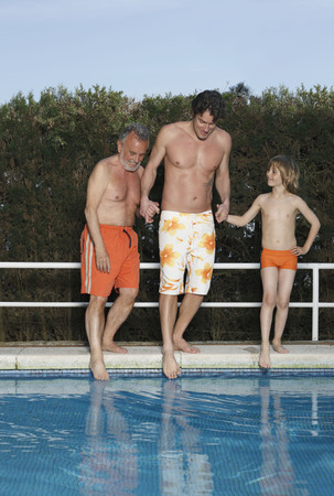 Family dipping toes into pool
