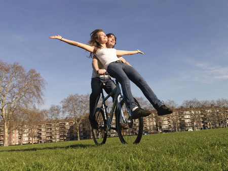 lodgings: Man and woman riding bicycle