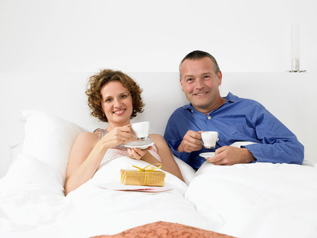 gals: Portrait of man and woman in bed
