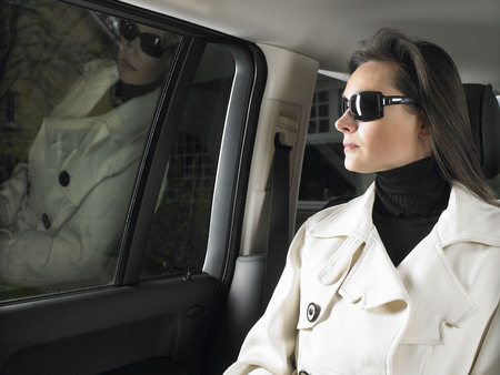 taxicabs: Woman in car, sunglasses on LANG_EVOIMAGES