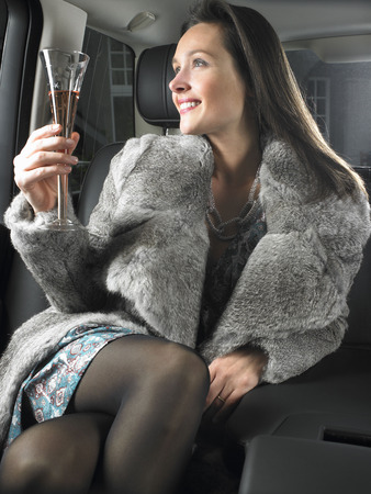 notoriety: Woman in car, drinking and celebrating
