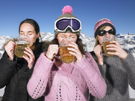 rejuvenated: Young women having drink at mountains