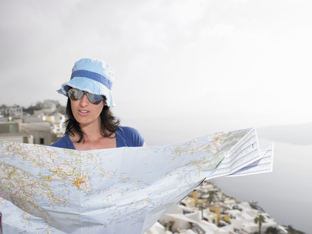 lodgings: Woman looking at a map