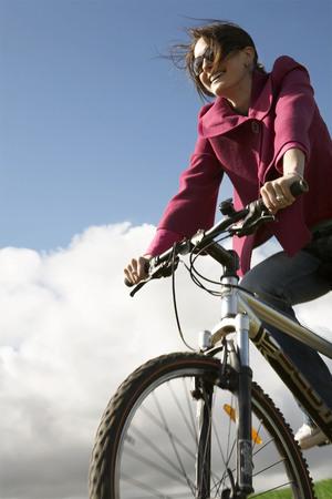 potěšen: Žena na kole LANG_EVOIMAGES