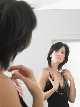 gals: Woman looking at herself in the mirror