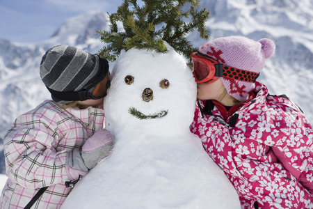 joyous: Two girls with a snowman