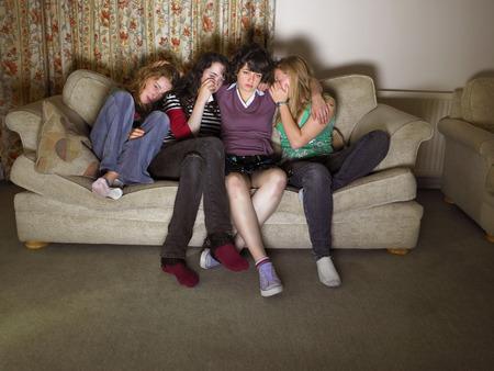cried: Women, sitting on sofa, looking sad