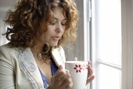 Woman holding cup of warm drink
