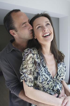 smooch: Couple smiling, portrait