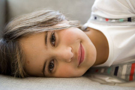 Girl lying and looking into the camera