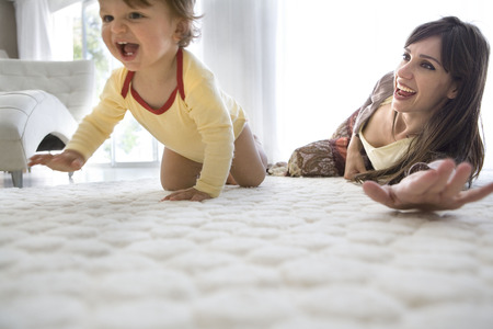 whimsy: Baby first crawls, mother watches