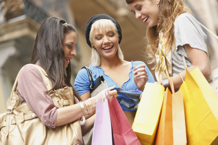 chic woman: Young women walking with shopping bags LANG_EVOIMAGES