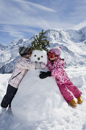 whimsy: Two girls with a snowman