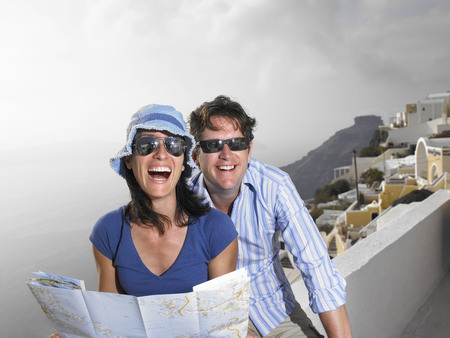 honeymooner: Couple looking at a map, laughing