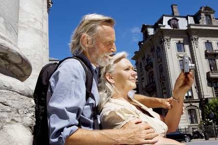 sightseers: Couple looking at camera