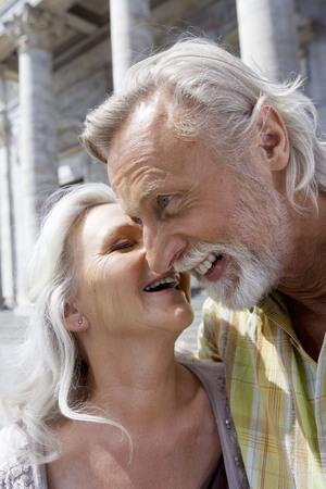 rejoices: Woman kissing man