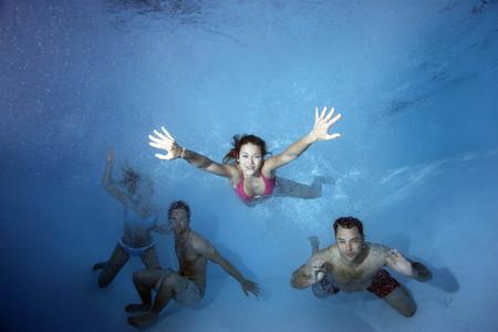 reaches: Group swimming underwater
